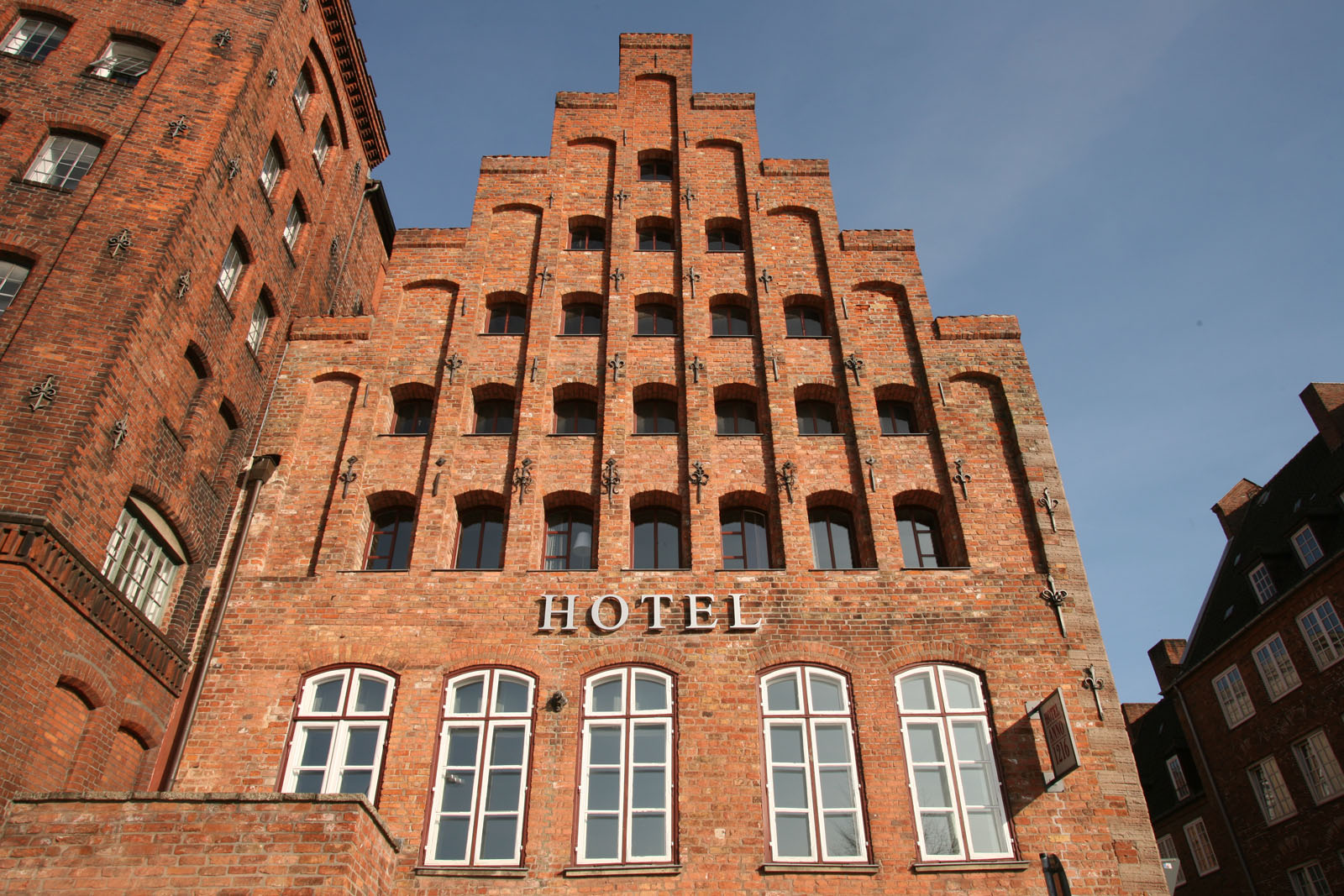 Hotel Building Made Of Brick With Gabled Roof